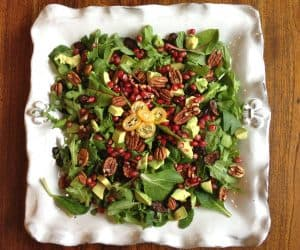 Winter salad with dried figs, pomegranate, avocado, and pecans