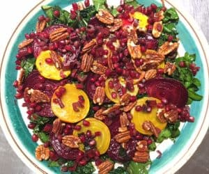 Winter Greens Salad with Golden Beets, Pomegranate, Pecans, and Warm Balsamic Vinaigrette