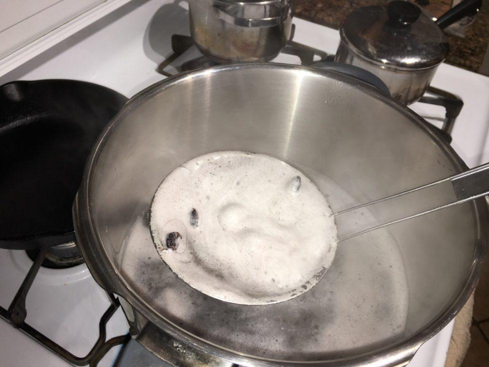 image of black beans being skimmed
