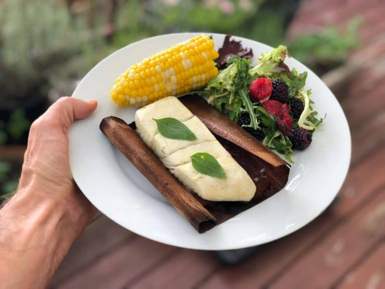 Grilled halibut in cedar wrap with sweet corn and salad