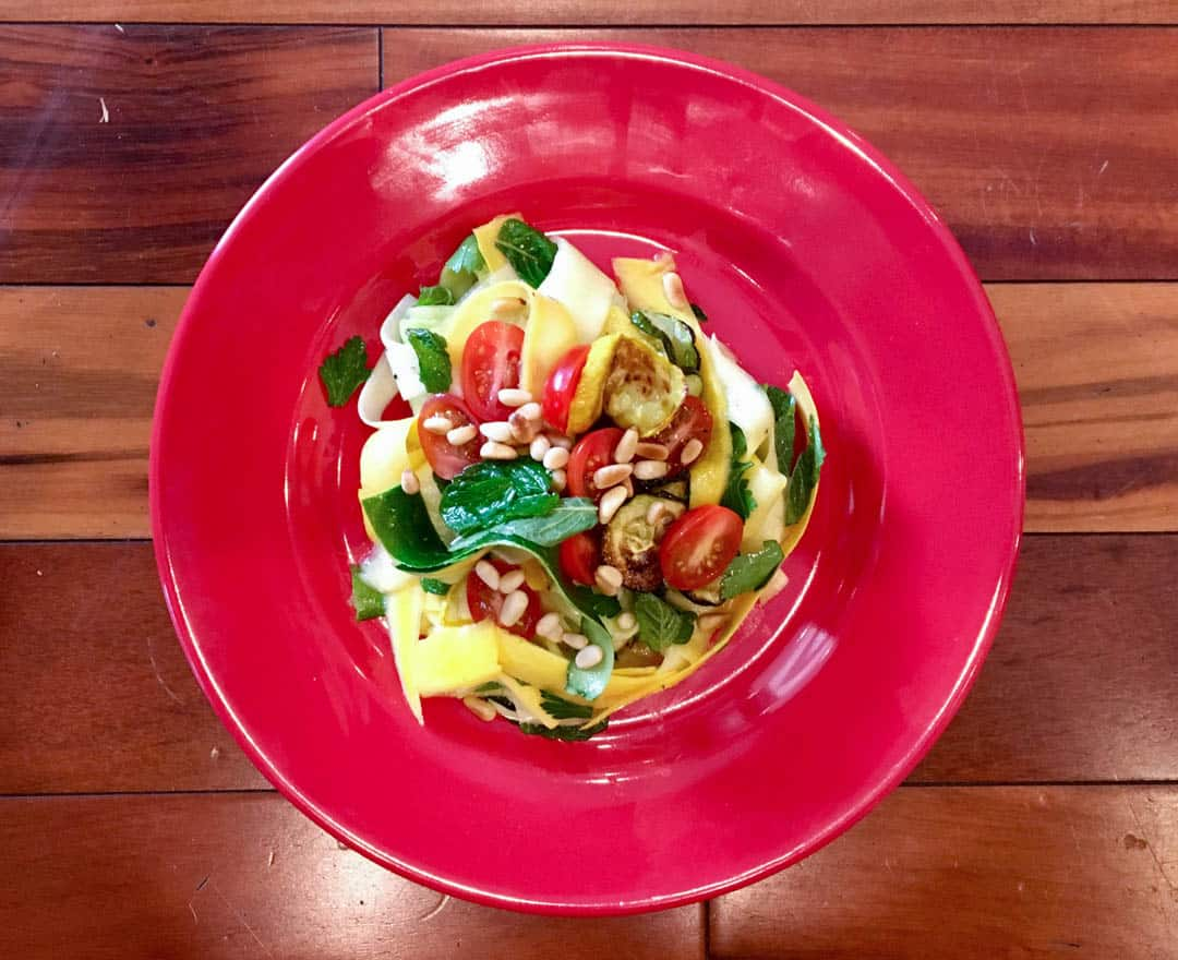 photo of zucchini salad on red plate